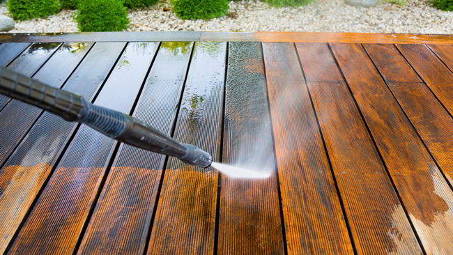 Power wash the deck, driveway, and porch