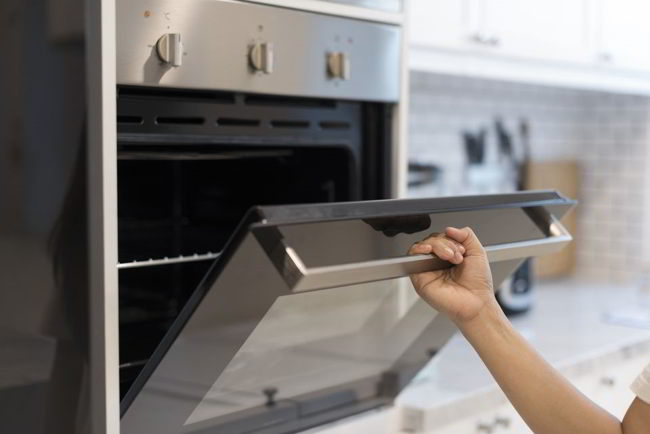move out cleaning checklist: Scrub the Oven and the Stove