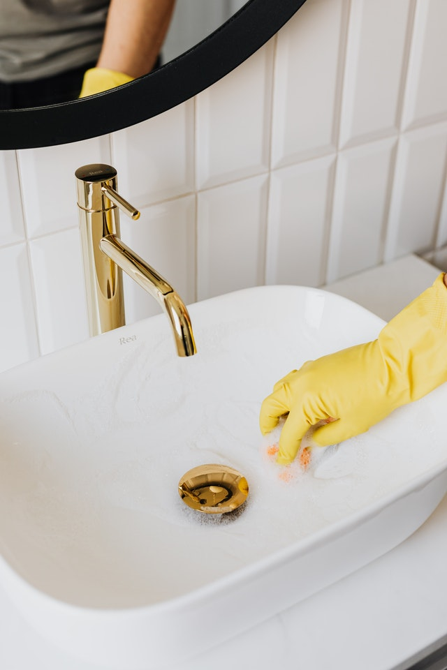 deep apartment cleaning using gloves wear gloves